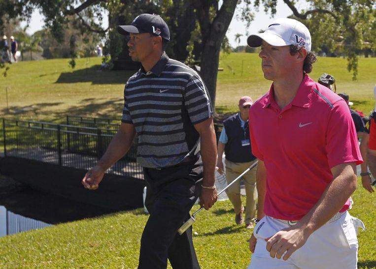 Tiger Woods (links) en Rory McIlroy. Beeld reuters