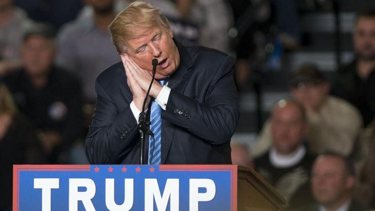 Ze durven het niet hardop te zeggen, maar de partijgenoten van Donald Trump hopen maar al te graag dat hij er niet in slaagt genoeg stemmen binnen te slepen. Beeld afp
