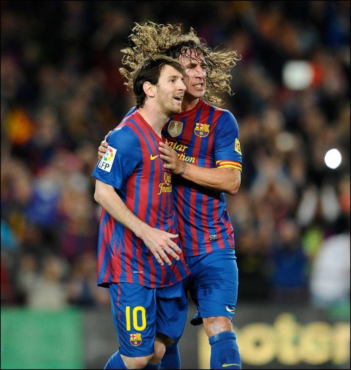 Messi en Puyol.