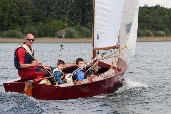 Maarten De Rijk met Lucas (8) en Warre (11).