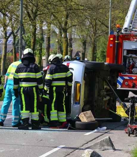 Bejaarde man uit gekantelde auto bevrijd na ongeluk in Boxtel