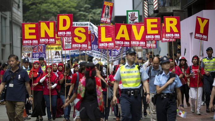 Indonesische migranten demonstreren tegen hun arbeidsvoorwaarden in Hongkong