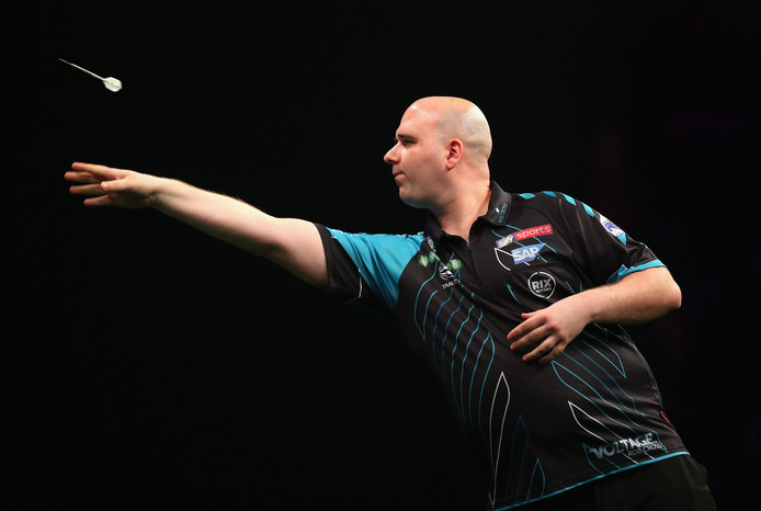 MANCHESTER, ENGLAND - APRIL 26:  Rob Cross in action during his match against Raymond van Barneveld in the 2018 Unibet Premier League at The Manchester Arena on April 26, 2018 in Manchester, England.  (Photo by Alex Livesey/Getty Images)