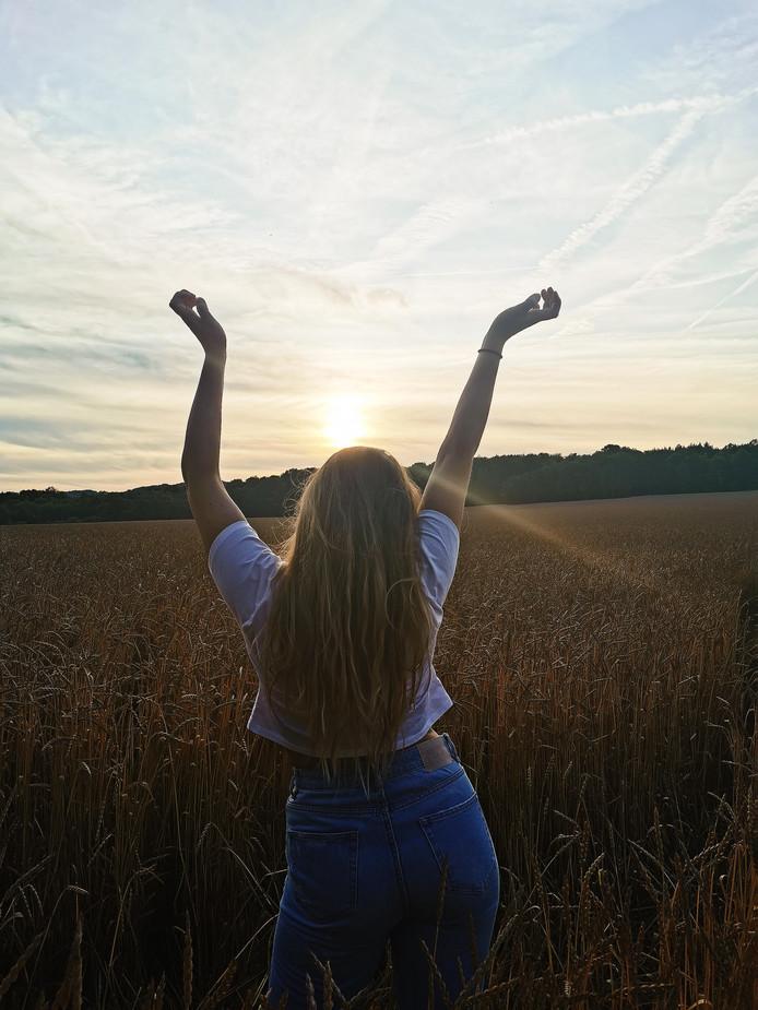 Een prachtige zonsondergang in de Ardennen in België. De fotografe wil graag meegeven: 'enjoy life!'
