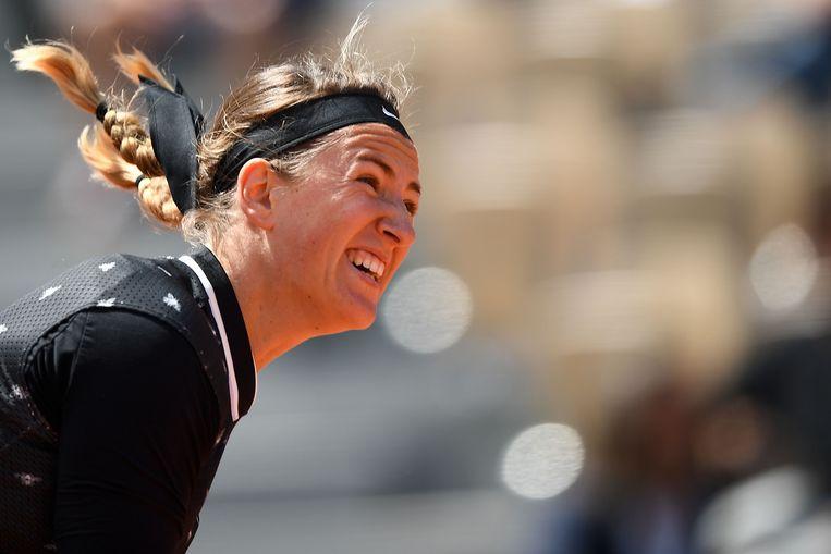 Victoria Azarenka in de wedstrijd tegen oud-winnares Jelena Ostapenko. Beeld AFP