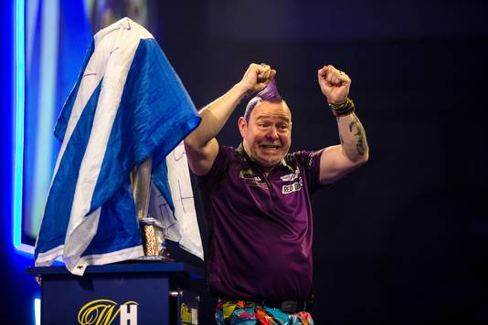 Peter Wright celebrates winning during day sixteen of the William Hill World Championships at Alexandra Palace, London.