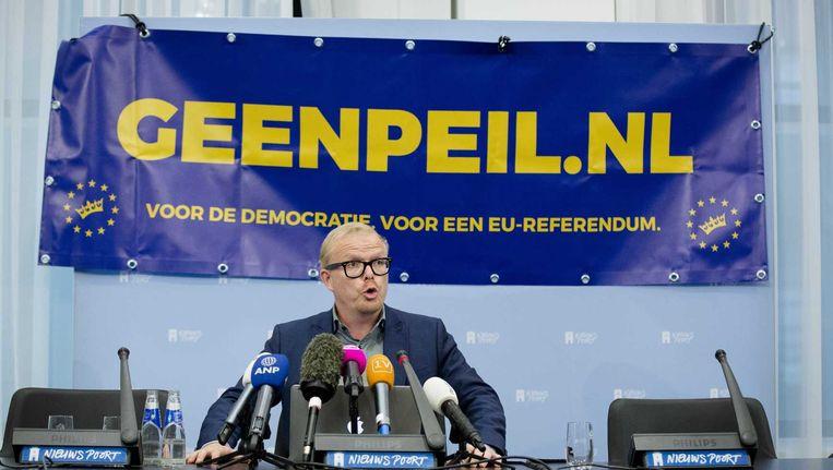 Jan Roos van het actiecomité GeenPeil tijdens een persconferentie. Beeld anp