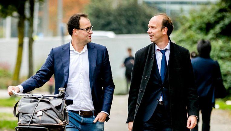 Robert Malewicz (l) en Sander Janssen (r) op weg naar een pro-formazitting in het Holleeder-proces in september vorig jaar. Beeld null