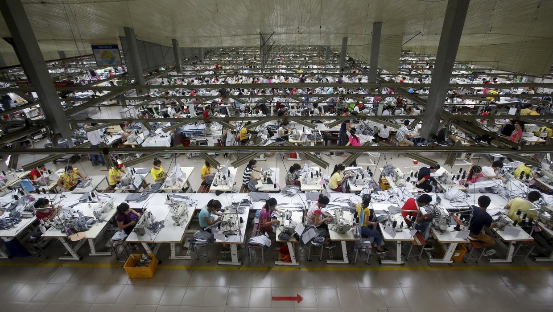 Robotarm vervangt Aziatische handen | De Volkskrant