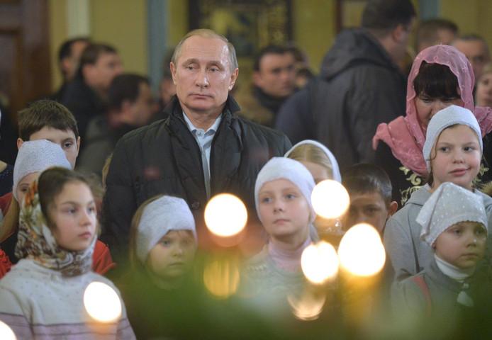 Poetin tijdens een kerstviering in het dorpje Turginovo