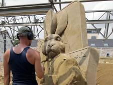Hoe maak je een zandsculptuur?Snijden, schaven en nathouden