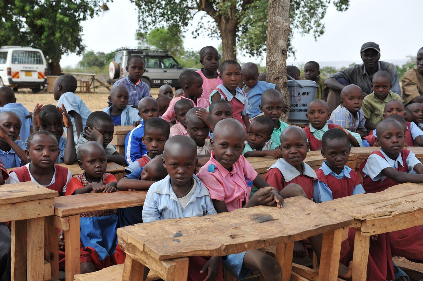 Bewoners zitten in de schoolbanken.