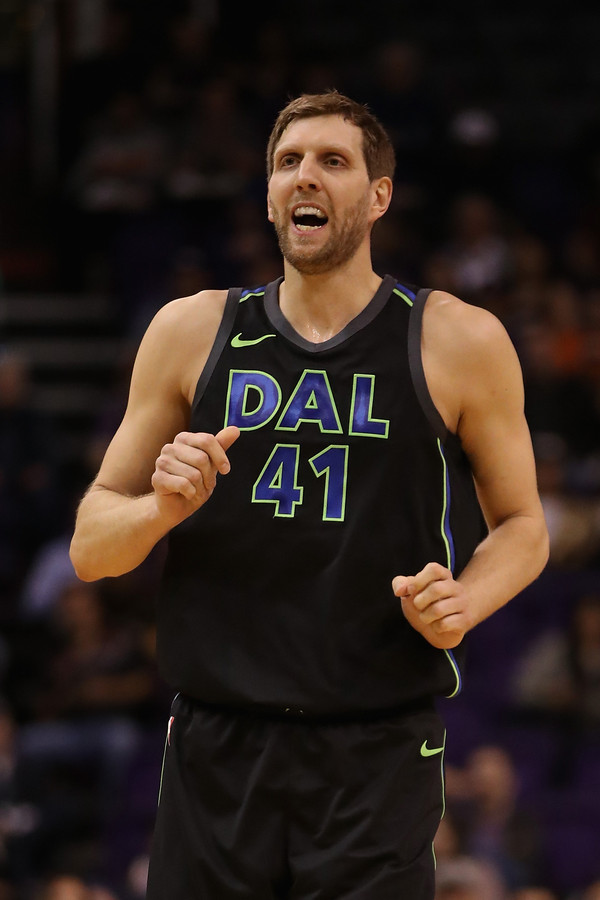 (FILES) This file photo taken on January 31, 2018 shows Dirk Nowitzki #41 of the Dallas Mavericks reacting to a missed shot during the first half of the NBA game against the Phoenix Suns at Talking Stick Resort Arena in Phoenix, Arizona. Germany's Dirk Nowitzki joined another elite NBA club when he reached the 50,000-minute milestone. Nowitzki has played his full 20-year NBA career with the Mavericks. He came  into the game February 5 needing seven minutes to reach the milestone and becomes just the sixth player to play at least 50,000 minutes in his career.  / AFP PHOTO / GETTY IMAGES NORTH AMERICA / Christian Petersen