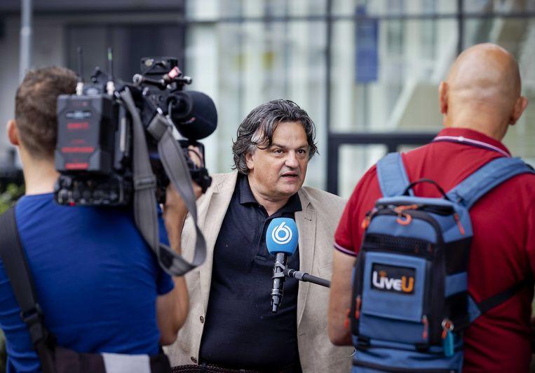 Ab Gietelink arriveert bij de rechtbank voor het kort geding over de mondkapjesplicht in Amsterdam.  Beeld ANP