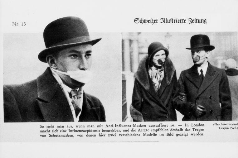 Mondkapjes tegen de Spaanse griep in Londen in 1918.  Beeld Getty Images