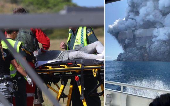 Hulpverleners bekommeren zich om een met reddingshelikopter overgebrachte gewonde op het vliegveldje van Whakatane.