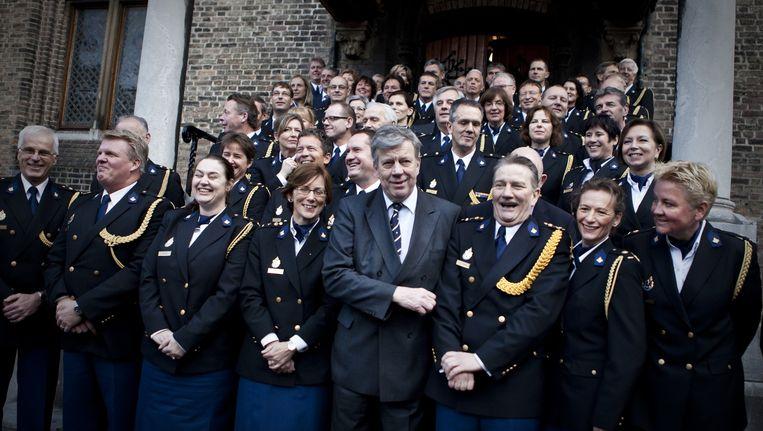 Gerard Bouman (derde van rechts) vol goede moed vlak na zijn installatie als korpschef van de Nationale Politie begin 2013. Links naast hem toenmalig minister van Veiligheid en Justitie Ivo Opstelten. Beeld null