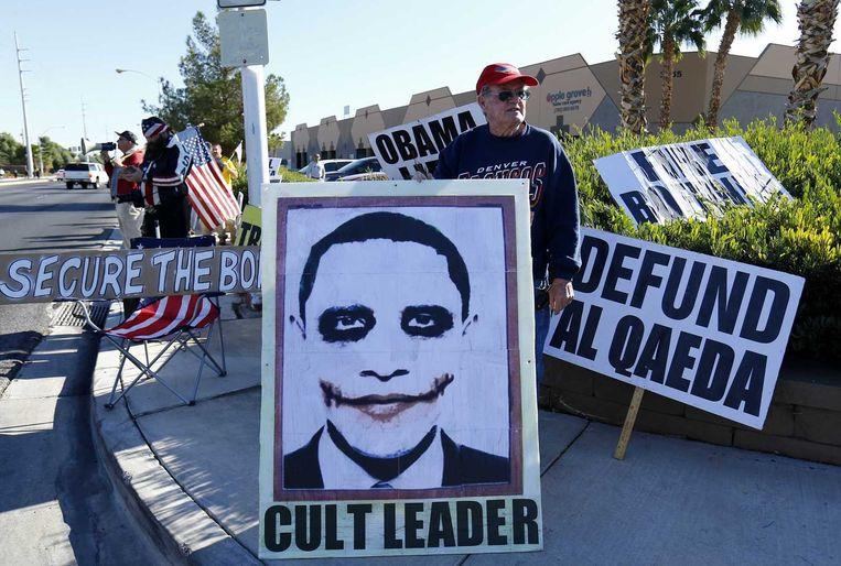 Een anti-Obama-demonstrant in Las Vegas, vrijdag. Beeld reuters
