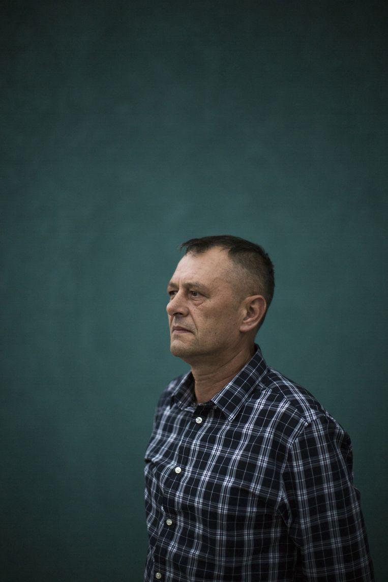 Nesib Mandzic (52). zonnepaneelverkoper, voormalig schoolhoofd. Was moslim-onderhandelaar. Beeld Julius Schrank