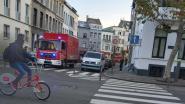 Twaalf bewoners geëvacueerd door uitslaande brand in Rotterdamstraat
