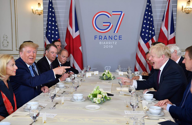 President Donald Trump (links) zondag op de G7-top in Biarritz. Beeld AFP