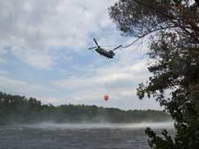 Grote bosbrand Loonse en Drunense Duinen: brandweerspecialisten blijven hele dag nablussen