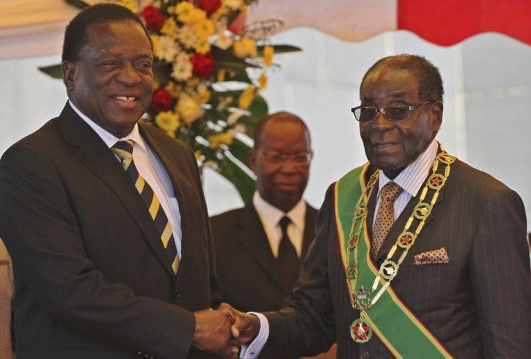 'Comrades': augustus 2015, vicepresident Mnangagwa en president Mugabe. Beeld reuters