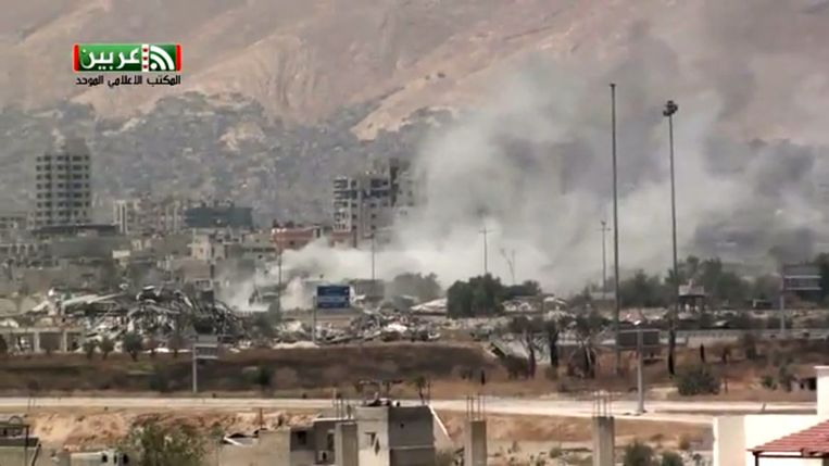 Beelden op de televisie van een aanslag in Al-Qaboun, Damascus. Beeld ap