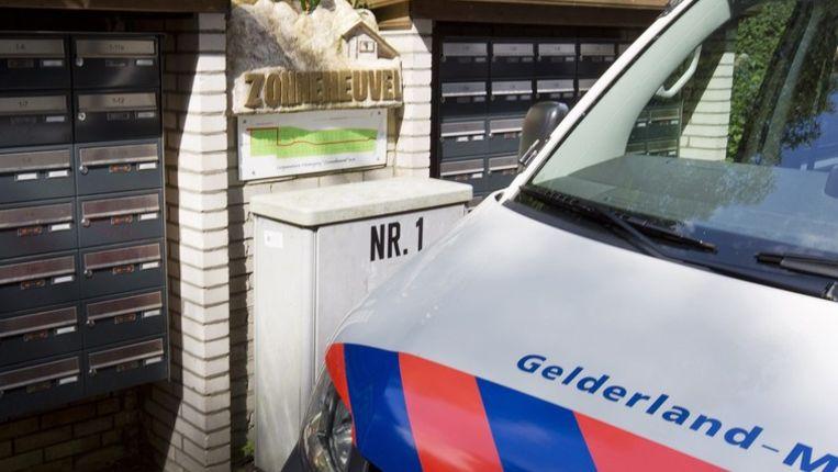 en politieauto staat bij bungalowpark Zonneheuvel. Beeld anp