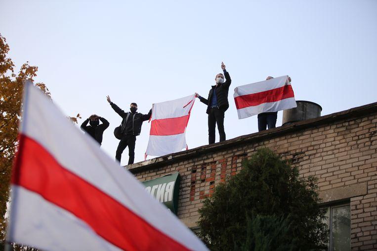 Demonstratie van de oppositie in Belarus zondag. Beeld REUTERS