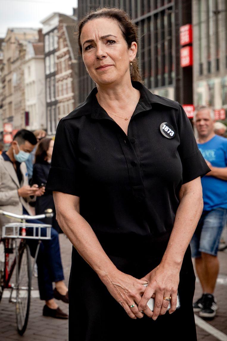 Femke Halsema, met button, bij het protest op de Dam. Beeld ANP