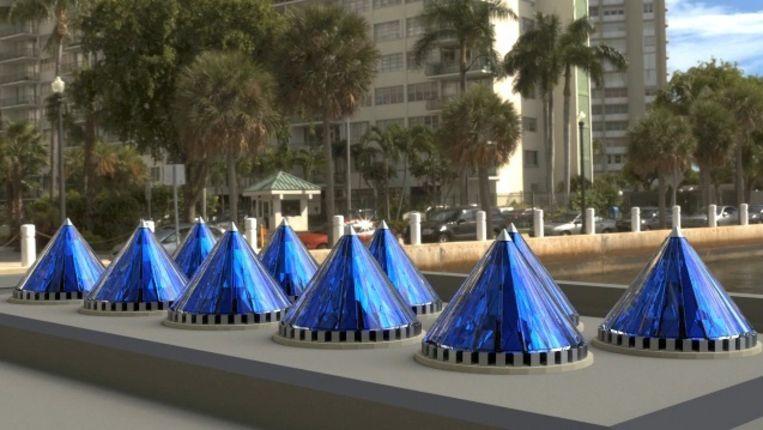 Tien draaiende piramides, in zonnig VS goed voor 10.000 kWh per jaar. Beeld Solarphasec