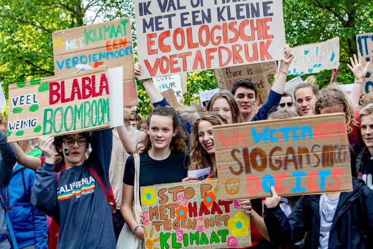 Scholieren houden een klimaatdemonstratie. Beeld ANP