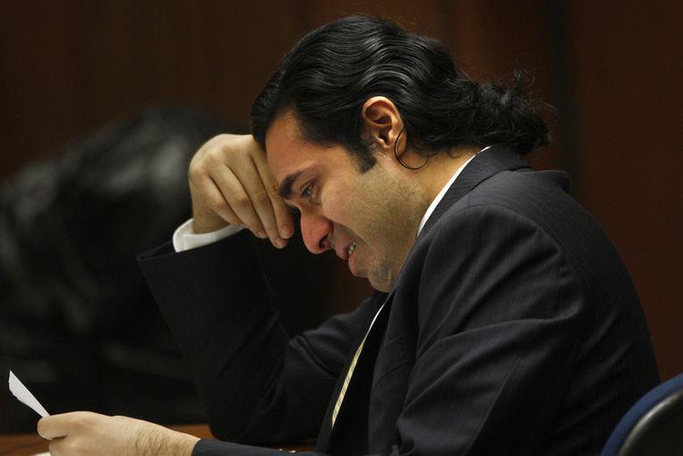 Ontwerper Anand Jon Alexander huilt bij het horen van het vonnis van de rechter. (ANP) Beeld