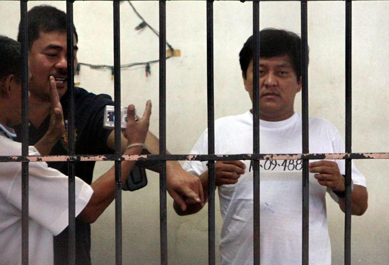 Hoofdverdachte Andal Ampatuan in 2009, kort na de massamoord, achter de tralies in Manilla. Beeld AFP