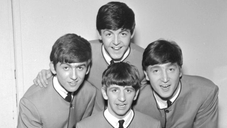 Paul McCartney (boven) en John Lennon (rechts) wilden zich al vroeg meten met grote songschrijvers. Beeld Getty