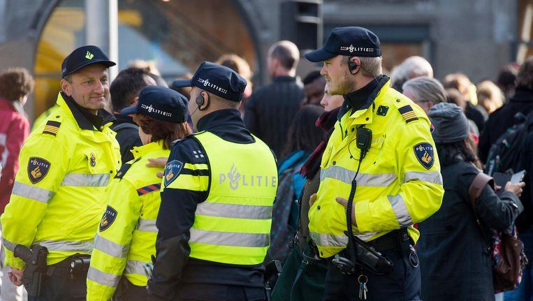 Het grote aantal evenementen waarbij de politie op moet draven vraagt volgens vakbond ANPV veel van het korps. Beeld anp