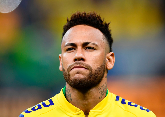 "(FILES) In this file photo taken on June 06, 2019 Brazil's Neymar warms up before a friendly football match against Qatar at the Mane Garrincha stadium in Brasilia ahead of Brazil 2019 Copa America. - Neymar is ready to cut his salary by 12 million euros to leave Paris Saint-Germain as part of a ""verbal agreement"" reached between the Brazilian and Barcelona, according to reports in the Spanish press released on June 25, 2019. (Photo by EVARISTO SA / AFP)"
