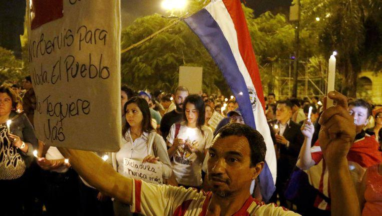 Een demonstratie tegen de grondswetwijziging die huidig president Horacio Cartes wil om nog een tweede termijn aan zijn ambtsperiode te plakken.