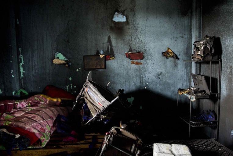Een kinderkamer in het verbrande huis. Bij de brand kwamen twee kinderen en vier volwassenen om. Beeld EPA