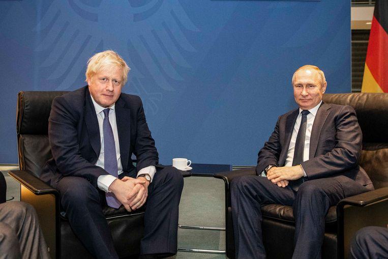 De  Britse president Johnson en de Russische president Poetin, tijdens ontmoeting op 19 januari in Berlijn. Beeld Downing Street
