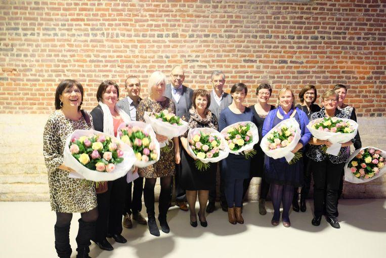 De medewerkers van Heilig Hart met 25 jaar dienst werden in de bloemetjes gezet.