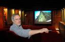Ed Hurkmans uit Moergestel in zijn eigen filmzaal.