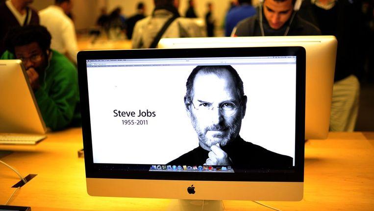 Een afbeelding van Steve Jobs als bureaublad in een Apple-winkel. Beeld null