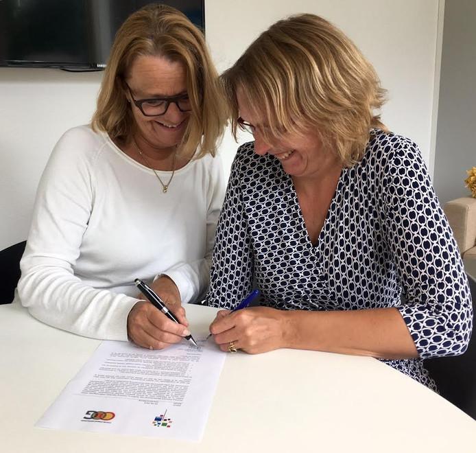 Edith van Montfort (College van Bestuur SKBO) en Sandra Beuving (College van Bestuur OOG)