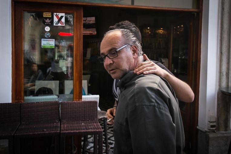 Bareigenaar Nikos Vourexakis vreest voor de toeristensector. Beeld null