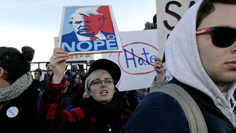 Demonstranten bij de rally in Chicago. Beeld ap