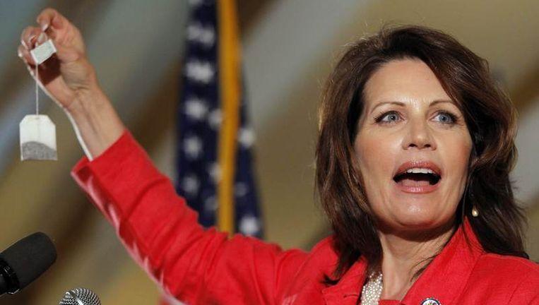 Michelle Bachmann met het symbool van de Tea Party. Beeld null