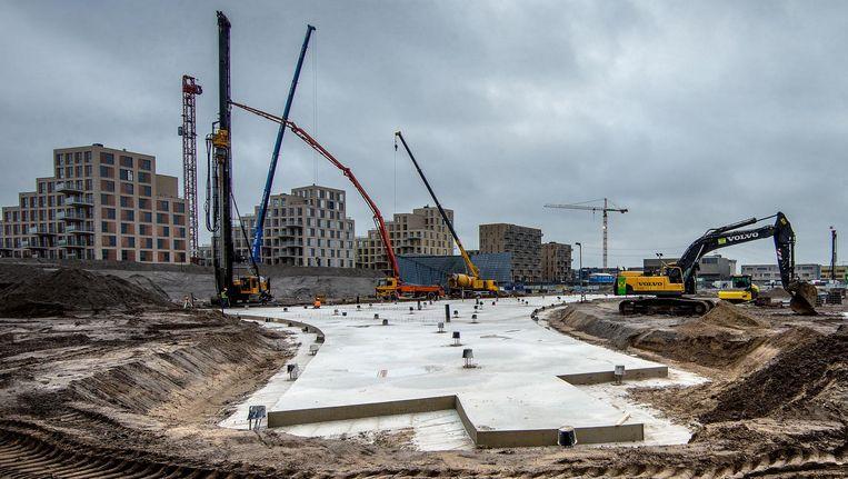Op Zeeburgereiland verrijst een woonwijk. In één jaar tijd zijn nog nooit zoveel woningen gebouwd in de stad. Beeld  Jean-Pierre Jans