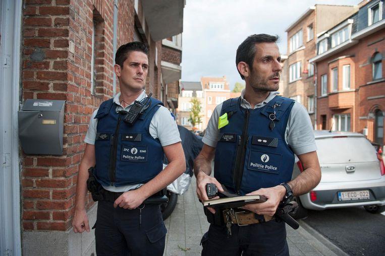 Agenten Gunther vanden Eynde (rechts) en Kristof Callaert. Beeld null